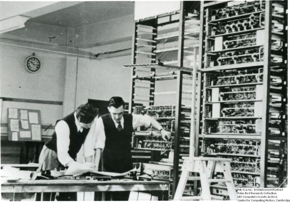 Photograph of 60761 Gordon Gibbs and Ray Shaw looking at a LEO I circuit diagram
