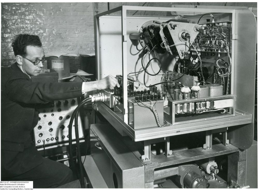 Photograph of 61019  Bill Dunlop working on wiring on the Rank prototype xerographic printer