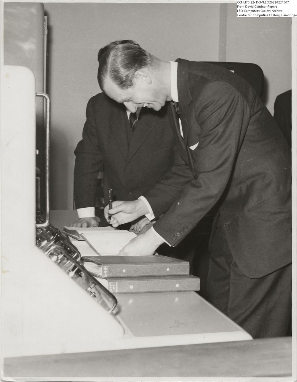 Photograph of 62962  Duke of Edinburgh signing the Visitors' Book (22nd Mar 1960)