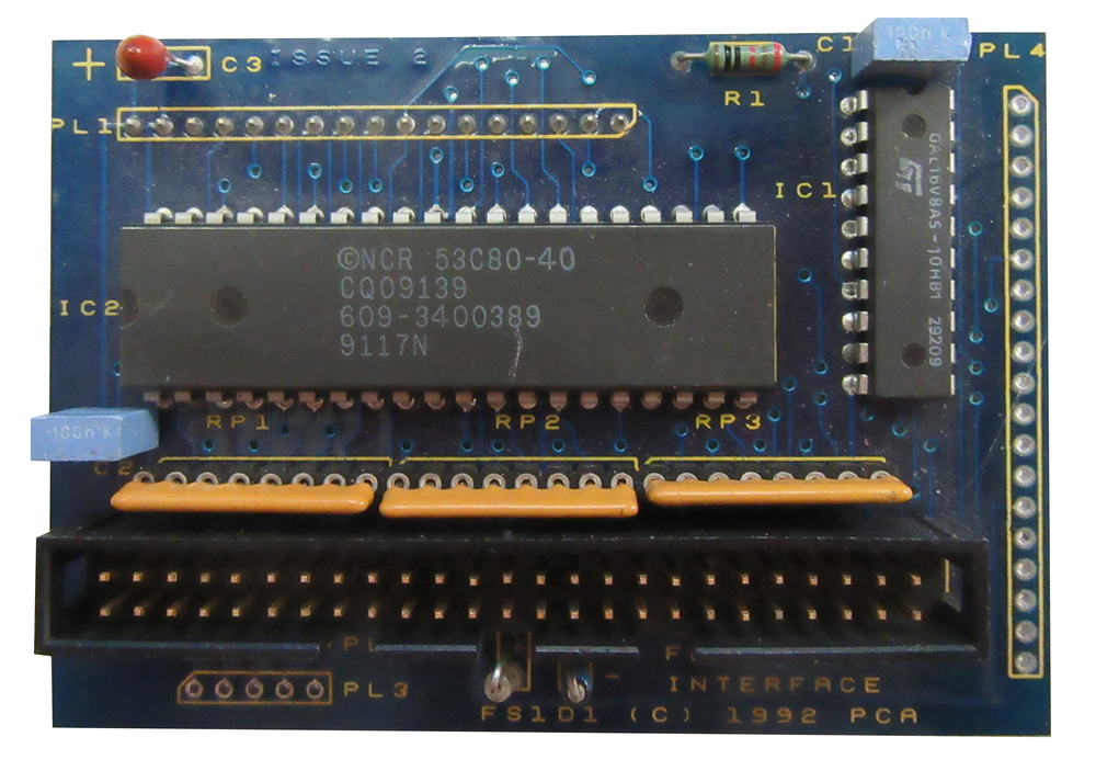 Scan of Document: The Serial Port A5000 Internal Floptical SCSI Interface